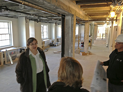 Peggy Sleeth and Susan Jorgensen in the north end of what will be the open study space with tables, chairs and couches.  This end also has 2 small class/meeting rooms.  The other end has an 18 seat classroom.